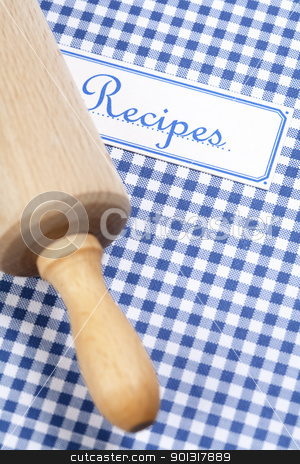cookbook and kitchenware stock photo, Blue cookbook and rolling pin by klenova