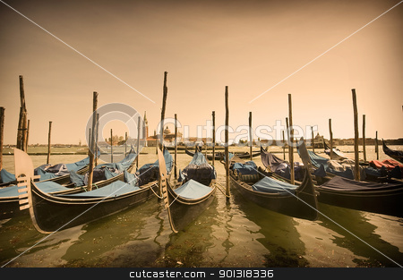 Parked gondolas in Venice, Italy stock photo, Many parked gondolas at the dusk in Venice, Italy by johnnychaos
