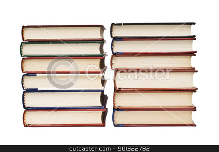 Two piles of books. stock photo, OLd books isolated over a white background. by angelsimon