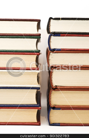 Book piles. stock photo, OLd books isolated over a white background. by angelsimon
