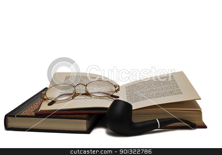 Smoking and reading. stock photo, Old books and a pair of glasses isolated over a white background. by angelsimon