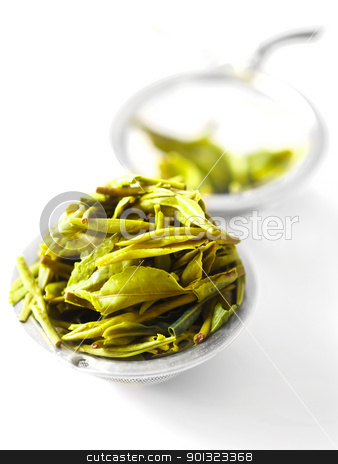 chinese tea leaves stock photo, chinese tea leaves in a tea filter by zkruger
