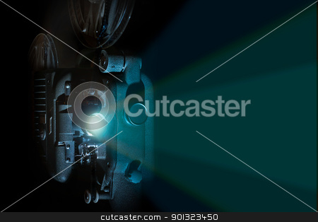 Vintage 8mm film projector light beam stock photo, Vintage 8mm film projector in dark room with reels and light beam by AGcuesta