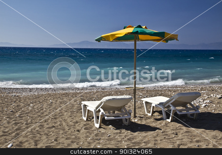 Tropical beach  stock photo, Chairs and umbrella on the beach   by Ingvar Bjork