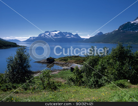 Ocean fjord in Norway  stock photo, Beautiful view of ocean fjord in Norway with snow mountains by Ingvar Bjork