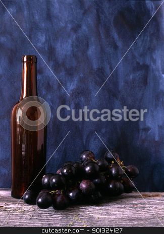 wine bottle and grapes stock photo, Wine bottle and grapes isolated on painted background by Ingvar Bjork