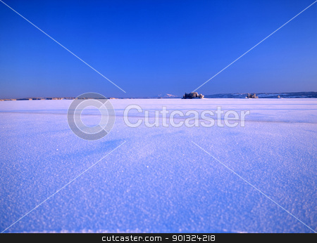 snowy landscape and blue sky stock photo, Landscape image of a snowy meadow and blue sky by Ingvar Bjork
