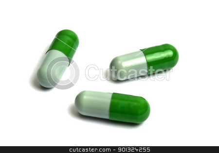 Capsules stock photo, Green capsules isolated on white by Ingvar Bjork