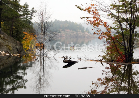 Reflection stock photo, Canoing at George Lake in overcast day. Killarney Prov. Park by Pavel Cheiko