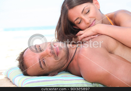 young affectionate couple resting at beach stock photo, young affectionate couple resting at beach by photography33