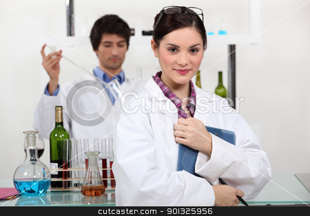 People working in a wine laboratory stock photo, People working in a wine laboratory by photography33