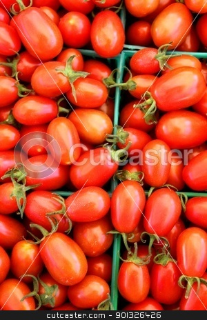 Cherry Tomatos stock photo, Baskets of red tomatoes at the farmers market by Henrik Lehnerer