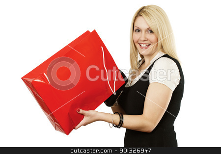 Shopping bag joy stock photo, A very happy shopping girl holding a shopping bag and smiling wildly after looking into it. by © Ron Sumners