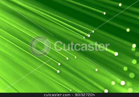 Fiber optical concept stock photo, Close up on the ends of a selection of illuminated light green fiber optic light strands with green background. by Samantha Craddock
