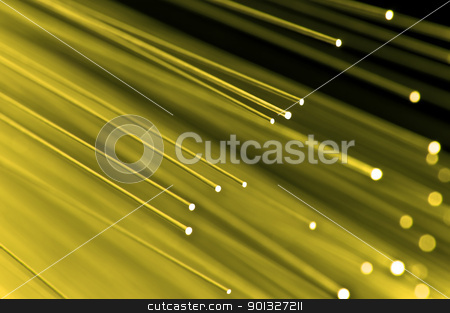 Bright fiber optic background stock photo, Close up on the ends of a selection of illuminated yellow fiber optic light strands with black background. by Samantha Craddock