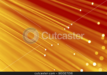 Abstract fiber optic background stock photo, Close up on the ends of a selection of illuminated golden fiber optic light strands with red background. by Samantha Craddock