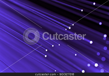 High speed violet concept stock photo, Close up on the ends of a selection of illuminated violet fiber optic light strands with black background. by Samantha Craddock