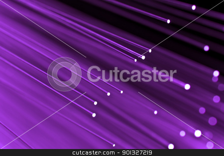 High speed technology concept stock photo, Close up on the ends of a selection of illuminated mauve fiber optic light strands with black background. by Samantha Craddock