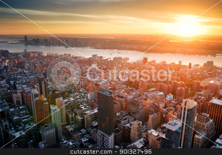 New York City sunset stock photo, New York City Manhattan sunset skyline aerial view with office building skyscrapers and Hudson River. by rabbit75_cut