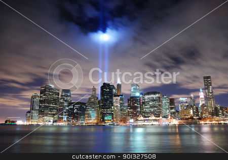 New York City Manhattan stock photo, Remember September 11. New York City Manhattan panorama view at night with office building skyscrapers skyline illuminated over Hudson River and two light beam in memory of September 11. by rabbit75_cut