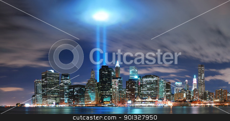 New York City Manhattan skyline illuminated over Hudson River  stock photo, Remember September 11. New York City Manhattan panorama view at night with office building skyscrapers skyline illuminated over Hudson River and two light beam in memory of September 11. by rabbit75_cut