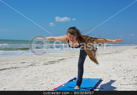 woman doing yoga exercise airplane posture on beach  stock photo, an athletic brown haired woman is doing yoga exercise airplane posture on an empty beach at the gulf of mexico in bonita springs florida by Stephen Orsillo