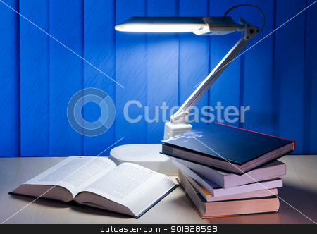 open book stock photo, open book and pile books is on desk by Salauyou Yury