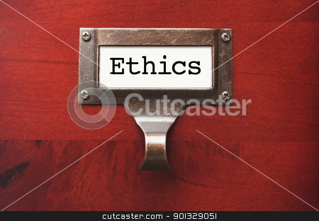 Lustrous Wooden Cabinet with Ethics File Label stock photo, Lustrous Wooden Cabinet with Ethics File Label in Dramatic LIght. by Andy Dean