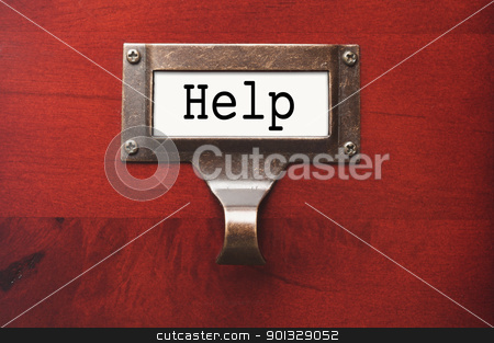 Lustrous Wooden Cabinet with Help File Label stock photo, Lustrous Wooden Cabinet with Help File Label in Dramatic LIght. by Andy Dean
