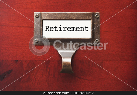 Lustrous Wooden Cabinet with Retirement File Label stock photo, Lustrous Wooden Cabinet with Retirement File Label in Dramatic LIght. by Andy Dean