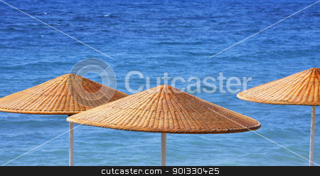 Beach Umbrelas stock photo, Beach umbrellas close up by Georgios Kollidas