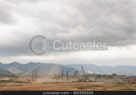 Construction and Nature stock photo, Dust flies with construction in developing Asia with mountains in the background by elemery