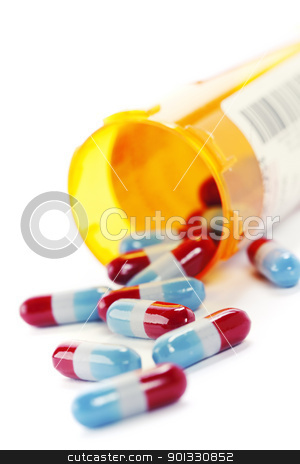 pharmaceutics stock photo, Pills spilling out of pill bottle isolated on white by klenova