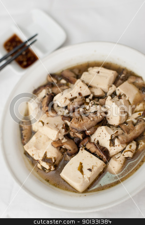 Simple bean curd delicacy stock photo, Typical Chinese style bean curd delicacy braised with black mushrooms. by Wai Chung Tang
