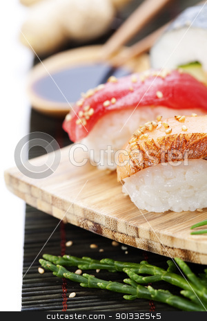 sushi stock photo, set of japanese sushi with chopsticks and soy sause over white by klenova