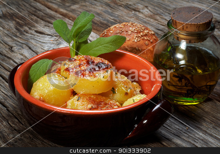 potatoes au gratin stock photo, baked potatoes au gratin on a earthen bowl by maxg71