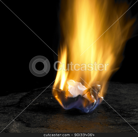burning paper stock photo, studio shot of burning rumpled piece of paper with big flame in dark back by prill