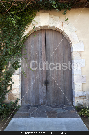 Wood Doors stock photo, An old doorway with a pair of wood doors by Kevin Tietz