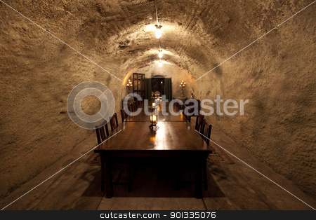Table in Cave stock photo, A dining room table inside a cave by Kevin Tietz