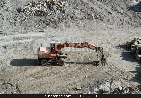 resting red quarry digger stock photo, red stone pit digger after work in sunny ambiance, seen from above by prill