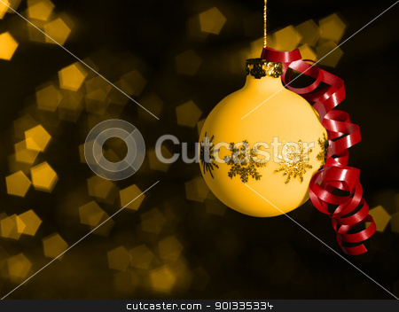 Christmas bauble in blurry back stock photo, warm illuminated Christmas bauble with red bow in front of blurry back by prill