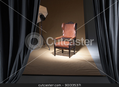 chair in a photostudio stock photo, old fashioned chair in studio ambiance by prill