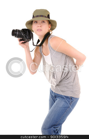 Casual girl with photocamera stock photo, Casual smiling girl-tourist in jeans with professional digital photocamera is looking for picture isolated on white background by Iryna Rasko
