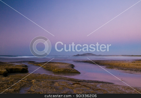 Twilight after a sunset at a beach stock photo, Twilight after a sunset at a beach, with long exposure, rock formation in the ocean by Ulrich Schade