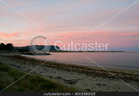 Twilight after a sunset at a beach, long exposure stock photo, Twilight after a sunset at a beach, with long exposure, rock formation in the ocean by Ulrich Schade