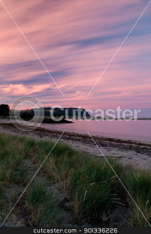 Twilight after a sunset at a beach, long exposure, rock formatio stock photo, Twilight after a sunset at a beach, with long exposure, rock formation in the ocean by Ulrich Schade
