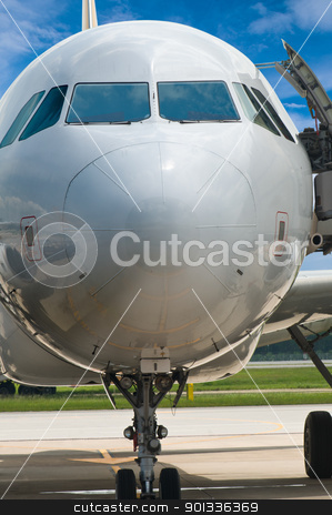 Closeup of airplane nose with pilot cabin against blue sky stock photo, Closeup of airplane nose with pilot cabin against blue sky by Ulrich Schade