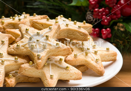Decorated christmas cookies in festive setting stock photo, Decorated christmas cookies in festive setting with tree decoration by Ulrich Schade