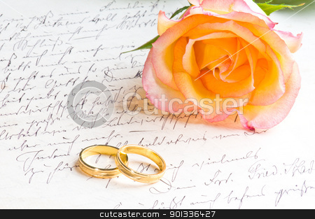 Rose and two rings over handwritten letter stock photo, Rose and two rings over handwritten love letter by Ulrich Schade