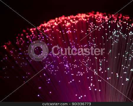 plastic optical fibers stock photo, colorful illuminated plastic optical fibers in dark back by prill